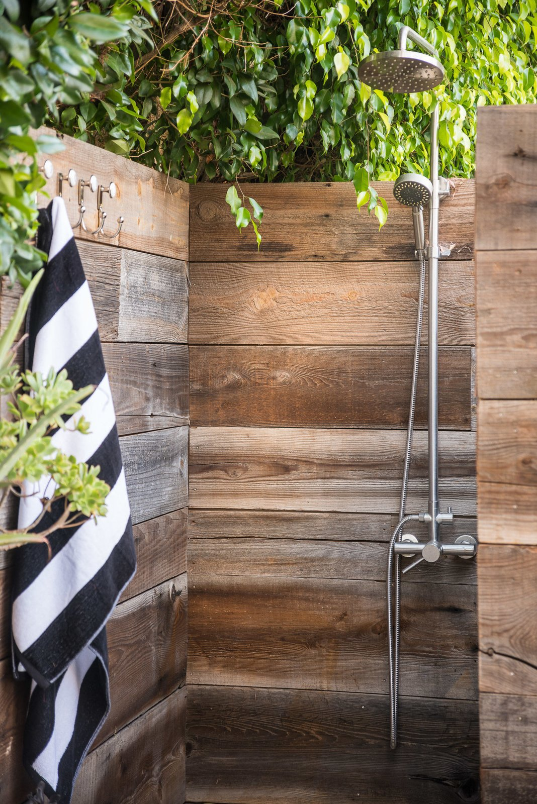 Tagged: Back Yard, Bath Room, and Open Shower.  Mid-Century Meets Boho Chic by Zillow