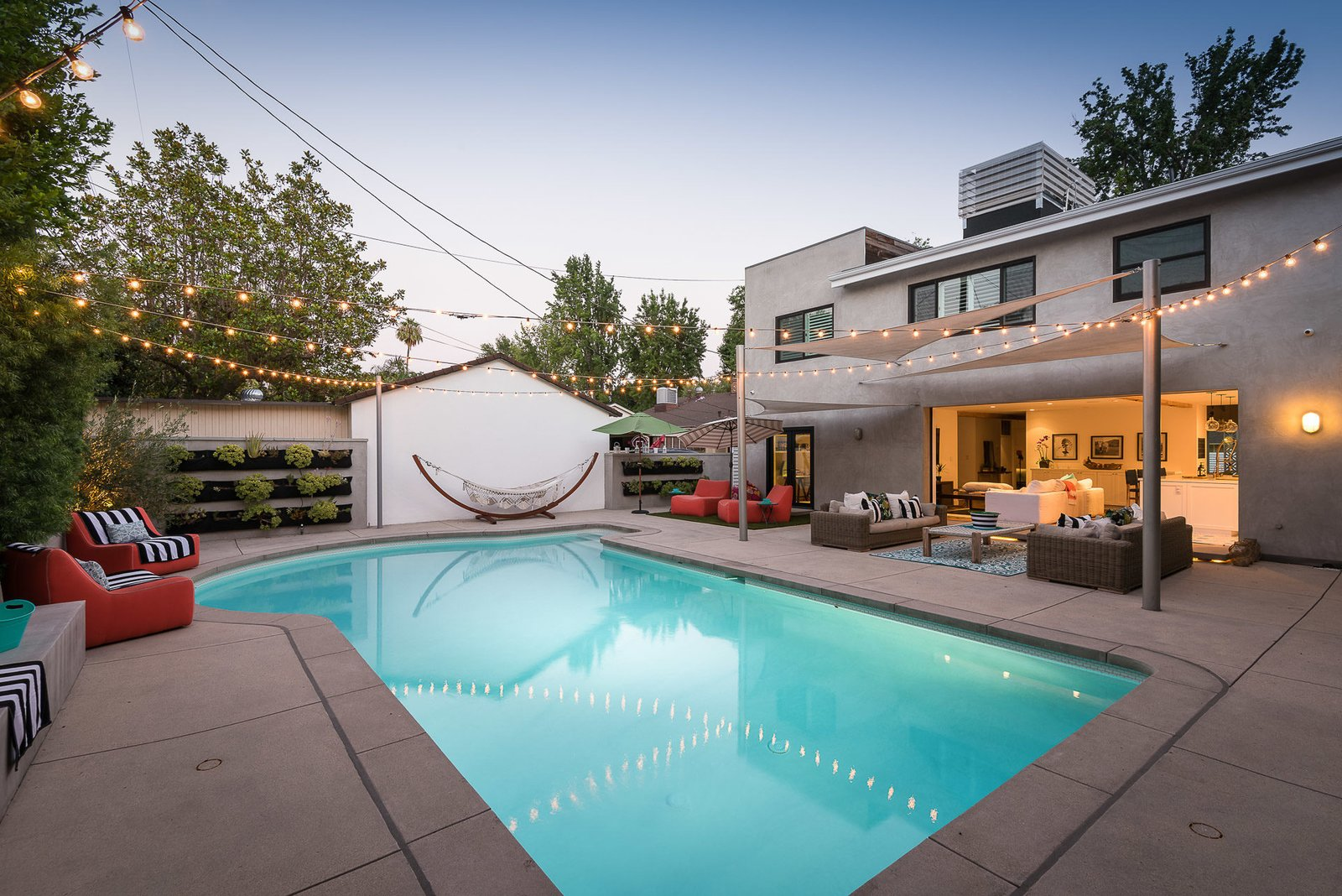 Tagged: Outdoor, Large Pools, Tubs, Shower, Plunge Pools, Tubs, Shower, and Back Yard.  Mid-Century Meets Boho Chic by Zillow