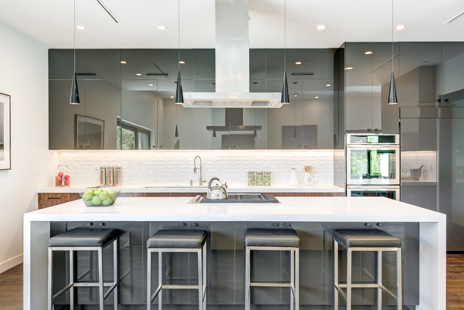 Tagged: Kitchen, Engineered Quartz Counter, Medium Hardwood Floor, Pendant Lighting, Refrigerator, Wall Oven, Ceiling Lighting, Drop In Sink, and Cooktops. 2701 Armacost by Zillow