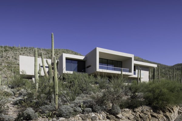 Modern home with sliding window type, metal, outdoor, slope, desert, front yard, and boulders. Photo  of Sabino Canyon Home