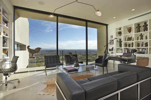 Modern home with office, library, study, den, chair, shelves, storage, lamps, desk, bookcase, and limestone floor. Photo 6 of Sabino Canyon Home