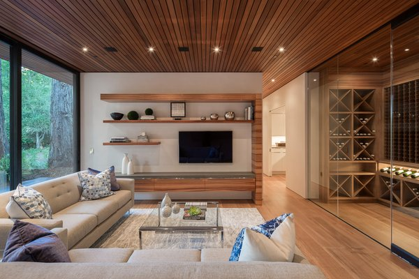 Modern home with living room, ceiling lighting, and light hardwood floor. Family room on main level Photo 4 of Woodside Way