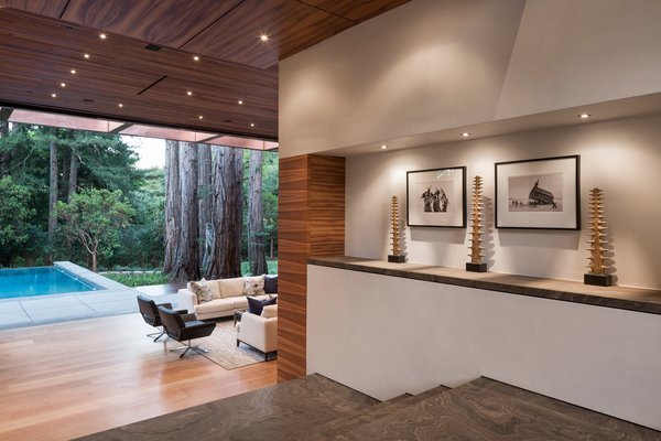 Incredible entry with limestone slab floors, Koa ceiling panels and Venetian plaster walls. Photo 2 of Woodside Way modern home