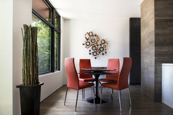 Modern home with dining room, chair, table, recessed lighting, and medium hardwood floor. Dining Room Photo 4 of Sanders