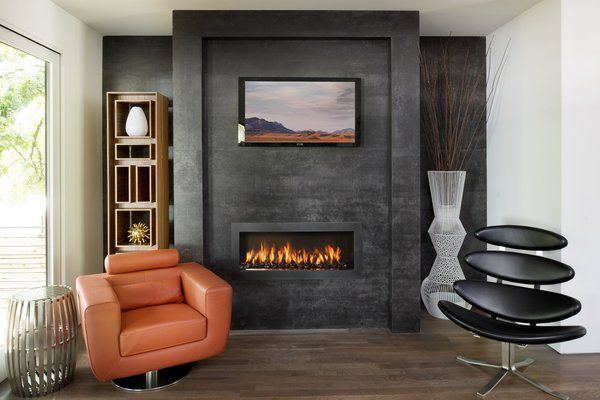Modern home with living room, gas burning fireplace, medium hardwood floor, standard layout fireplace, and recessed lighting. Fireplace Photo 6 of Sanders