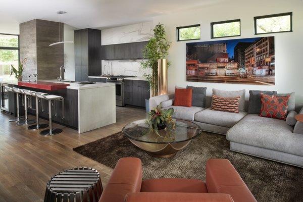 Modern home with living room, recessed lighting, medium hardwood floor, sofa, and chair. Living Room Photo 5 of Sanders