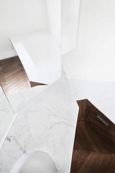 Modern home with bath room, drop in sink, medium hardwood floor, and accent lighting. Photo 20 of buda