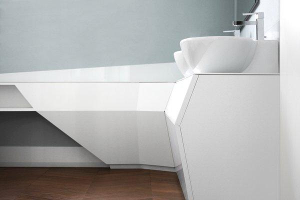 Modern home with bath room, medium hardwood floor, two piece toilet, drop in sink, and wall lighting. Photo 14 of buda