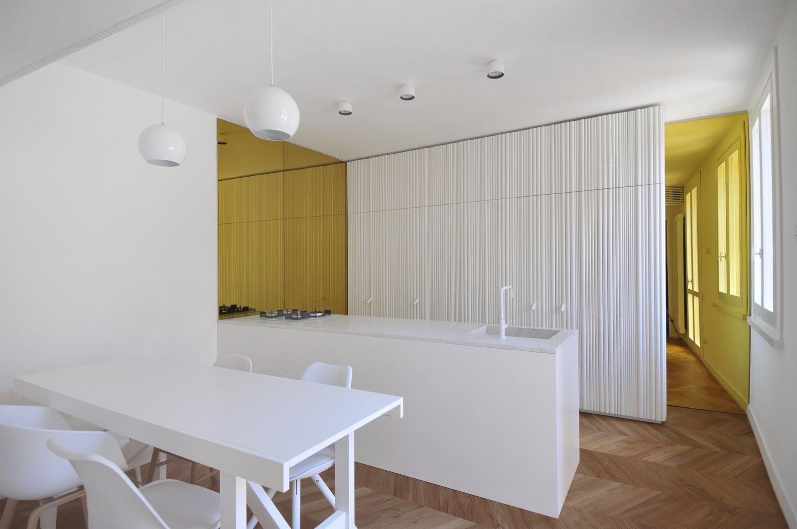 Tagged: Kitchen, Marble Counter, Light Hardwood Floor, Ceiling Lighting, White Cabinet, and Drop In Sink.  cdr by tissellistudioarchitetti