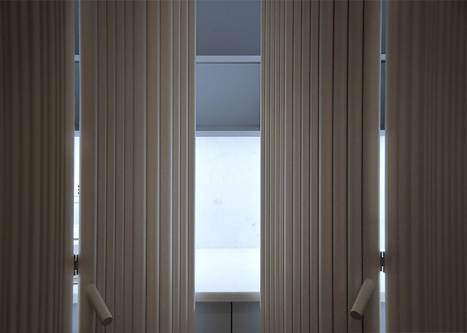 Tagged: Kitchen, Marble Counter, Marble Backsplashe, White Cabinet, and Light Hardwood Floor.  cdr by tissellistudioarchitetti