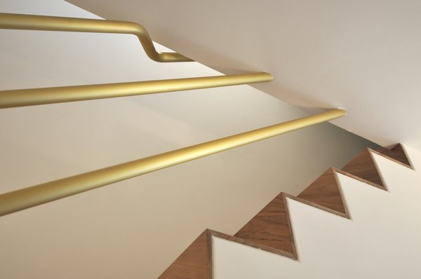 Modern home with staircase, wood tread, and metal railing. Photo 11 of cdr