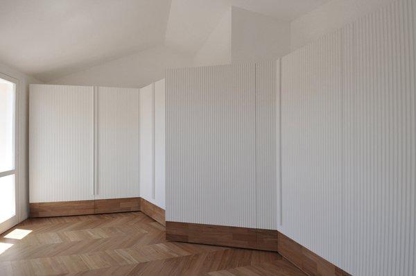 Modern home with bedroom, dresser, storage, wardrobe, accent lighting, and light hardwood floor. Photo 12 of cdr