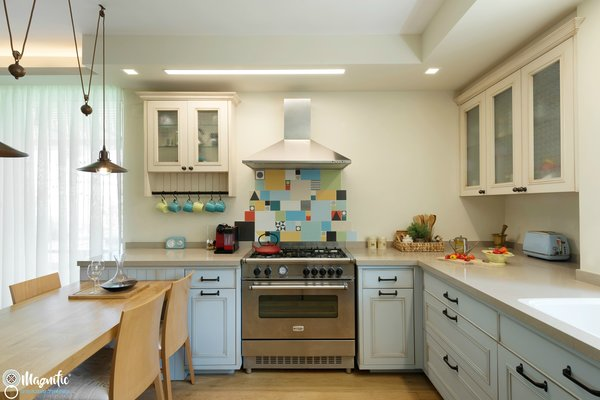 Modern home with kitchen, wood counter, tile counter, wood cabinet, medium hardwood floor, ceiling lighting, colorful cabinet, ceramic tile backsplashe, and range hood. A closer look at the kitchen Photo 2 of An Ideal Home Renovation for the Golden Years