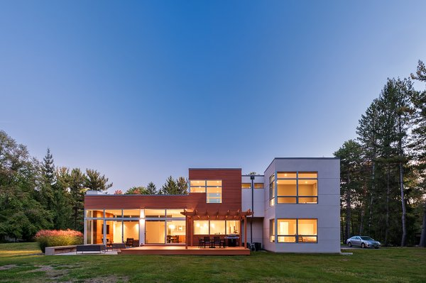 Modern home with outdoor, side yard, and wood patio, porch, deck. Photo  of Orange Residence