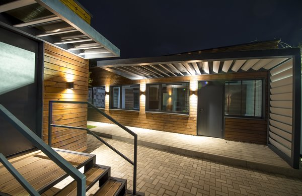 Modern home with cement tile floor, outdoor, walkways, and hanging lighting. Photo 5 of The container as a contemporary solution