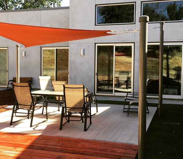 Modern home with outdoor, wood patio, porch, deck, walkways, back yard, and concrete patio, porch, deck. Throwing shade Photo 10 of 2017 Norton Jones