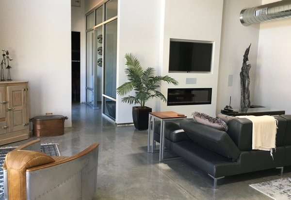 Modern home with living room, sofa, concrete floor, and ribbon fireplace. Living old versus new  Photo 7 of 2017 Norton Jones