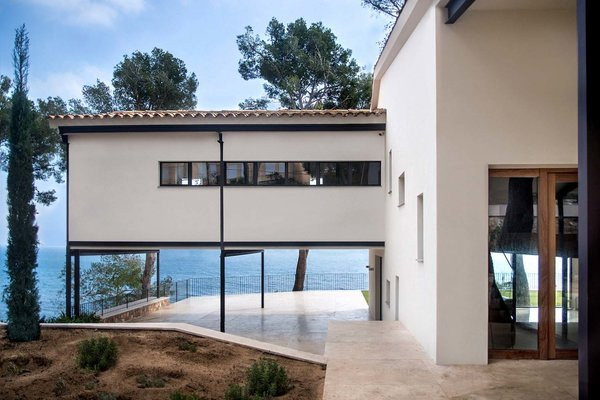 Modern home with outdoor, garden, stone patio, porch, deck, and metal patio, porch, deck. Photo 2 of ANDRESS HOUSE by Ros+Falguera Arquitectura