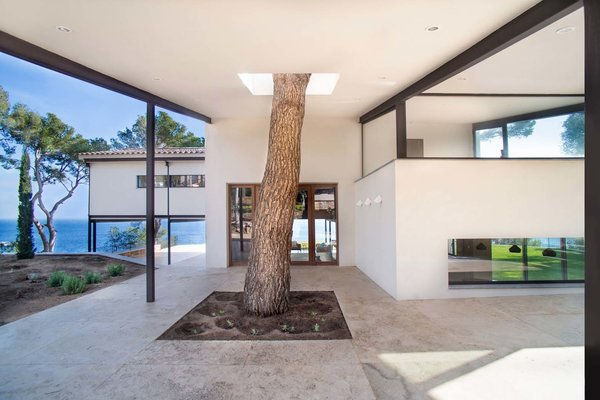 Modern home with outdoor, garden, stone patio, porch, deck, and trees. Photo 3 of ANDRESS HOUSE by Ros+Falguera Arquitectura