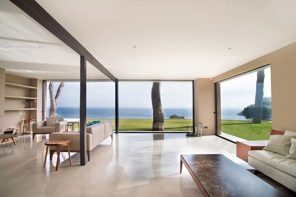 Modern home with living room, sofa, coffee tables, and bookcase. Photo 4 of ANDRESS HOUSE by Ros+Falguera Arquitectura