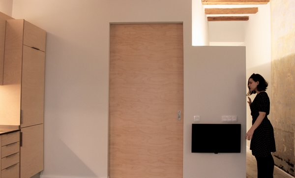 Modern home with kitchen. Photo  of ASSAONADORS FLAT by Ros+Falguera Arquitectura