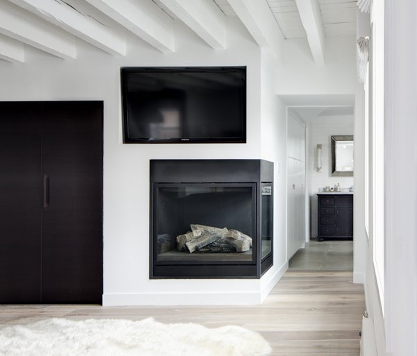 Modern home with living room and corner fireplace. Fireplace Photo 3 of Grand St. Residence