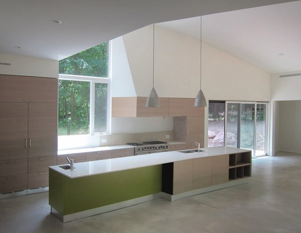 Modern home with kitchen, engineered quartz counter, wood cabinet, medium hardwood floor, ceiling lighting, pendant lighting, recessed lighting, and drop in sink. Kitchen View Photo 7 of DR Residence