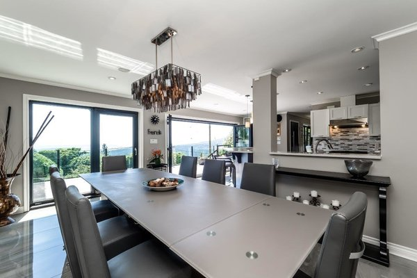 Modern home with dining room, ceiling lighting, and pendant lighting. Photo 5 of City and Ocean View Home