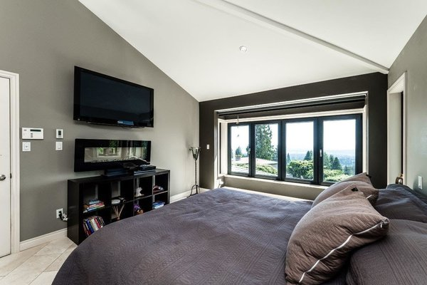 Modern home with bedroom. Photo 11 of City and Ocean View Home