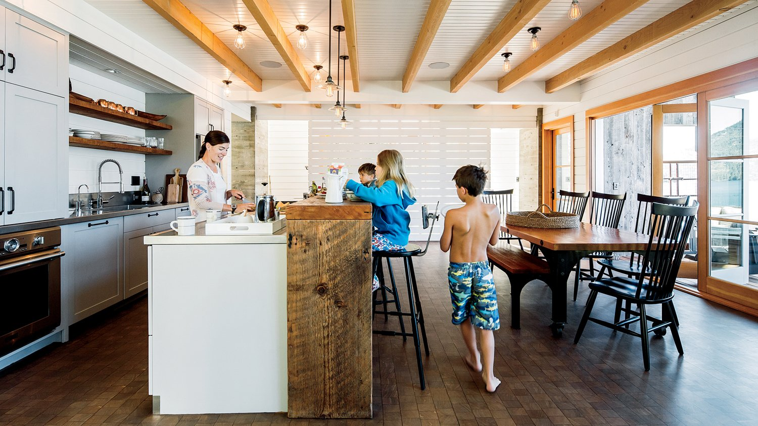 Lake Chelan Tagged: Kitchen, Dark Hardwood Floor, Engineered Quartz Counter, White Cabinet, Ceiling Lighting, Wall Oven, and Pendant Lighting.  Lake Chelan by Hoedemaker Pfeiffer
