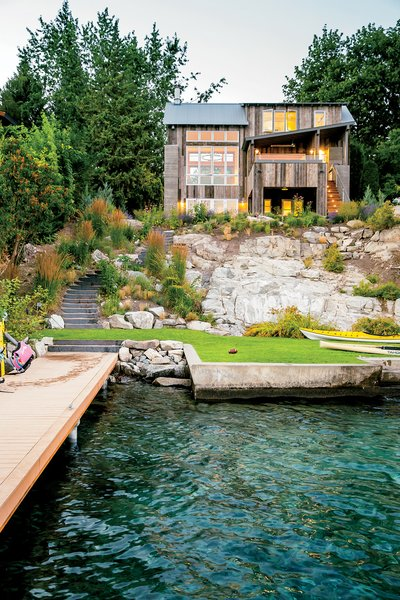 Modern home with outdoor, shrubs, back yard, wood patio, porch, deck, trees, and grass. Lake Chelan Photo 6 of Lake Chelan