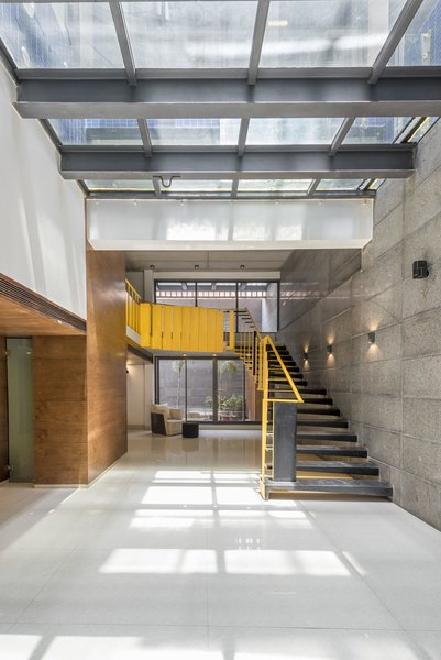 Sculpturesque yellow staircase at the basement Photo 5 of House B123 modern home