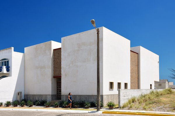Modern home with outdoor and front yard. Casa Iguana: North Facade. Photo  of Casa Iguana