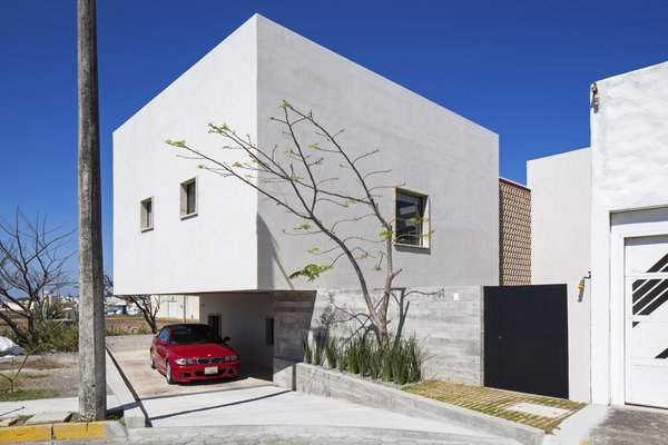 Modern home with kitchen. South Facade: Garage. Photo 3 of Casa Iguana