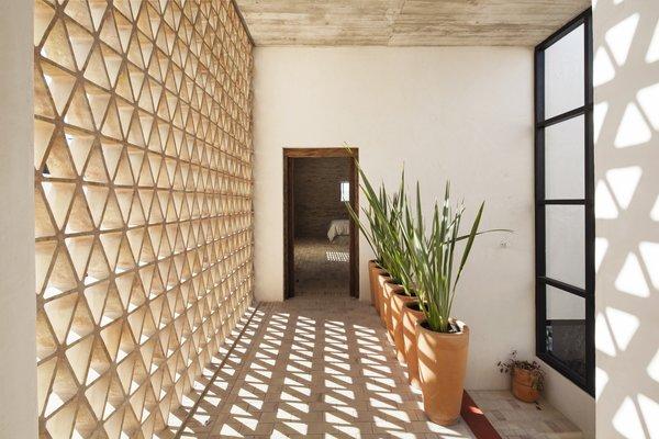 Modern home with hallway and brick floor. Aisle. Photo 10 of Casa Iguana