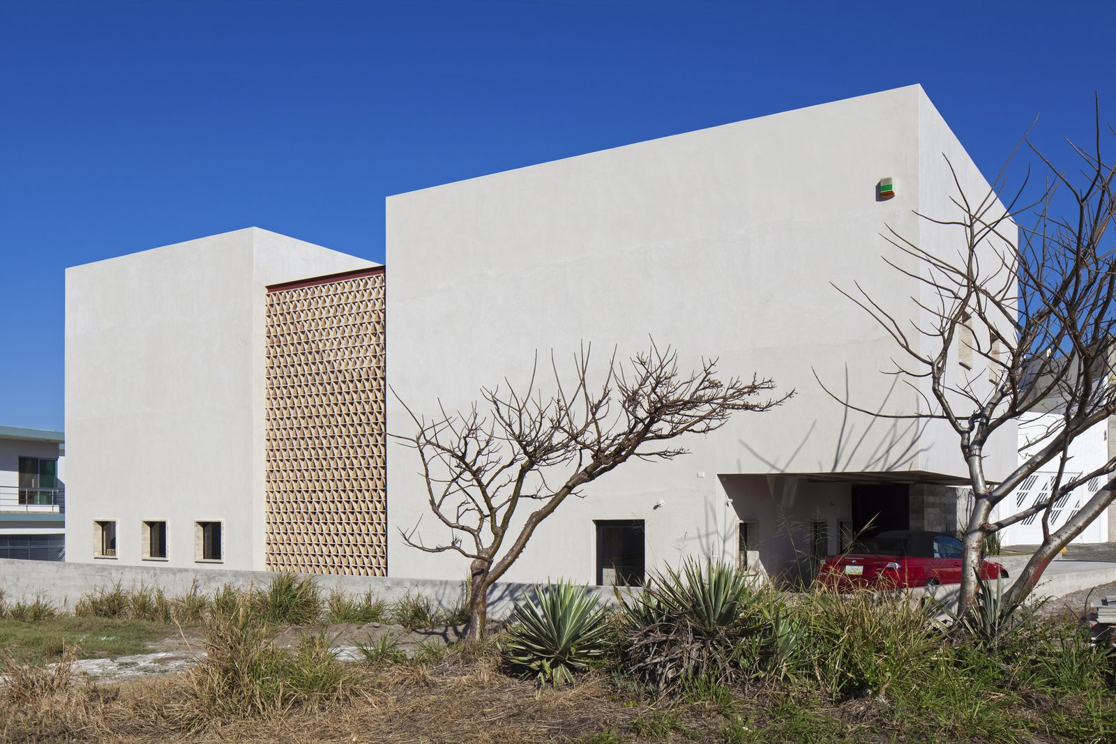 West Facade. Tagged: Outdoor and Side Yard.  Casa Iguana by OBRA BLANCA
