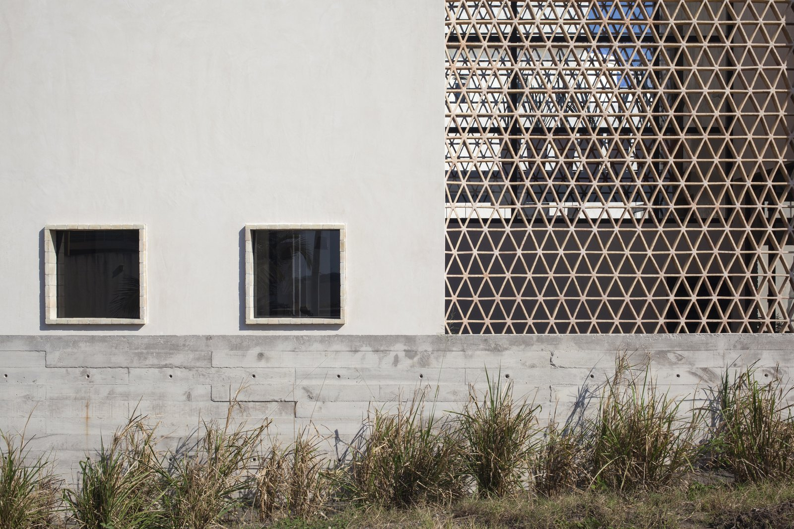 Concrete, clay bricks and chucum. Tagged: Outdoor and Horizontal Fences, Wall.  Casa Iguana by OBRA BLANCA