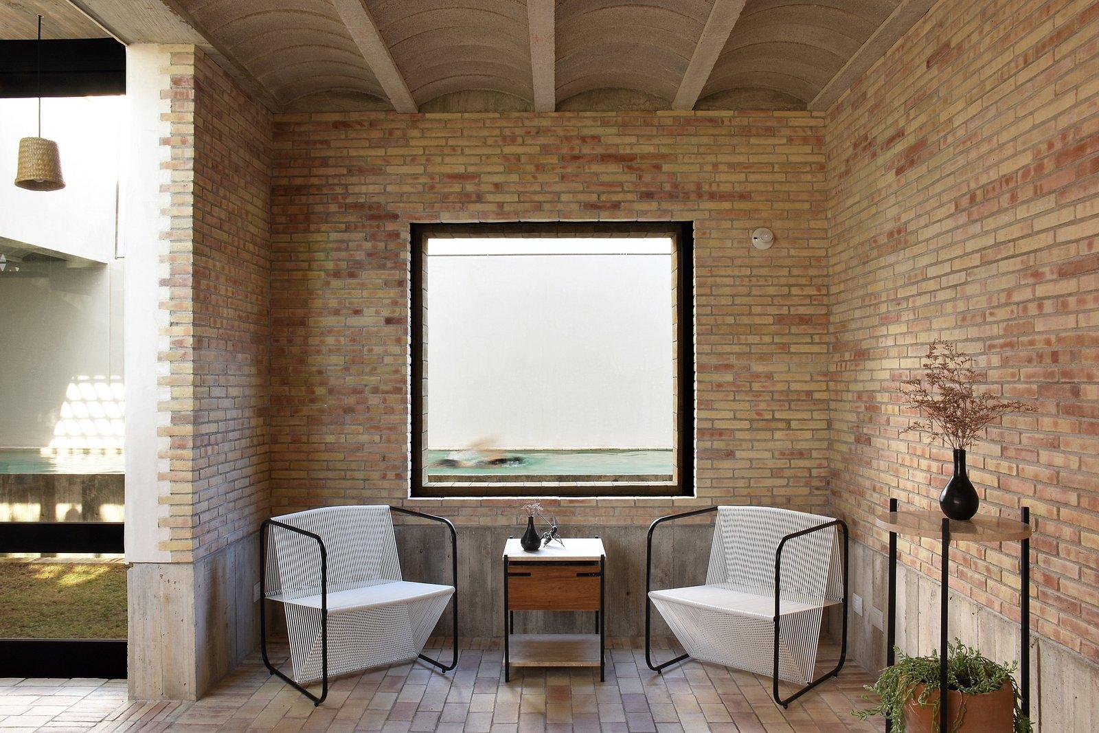 Dining room. Tagged: Chair, Windows, and Sliding Window Type.  Casa Iguana by OBRA BLANCA
