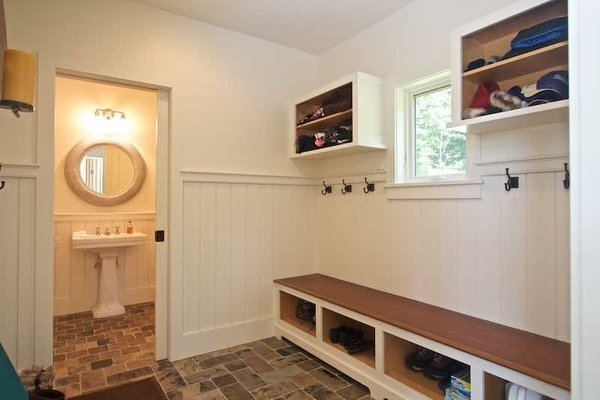 Modern home with hallway and slate floor. Mudroom off Gallery with Built ins for Storage and Half Bath Powder Room Photo 5 of Dennis Wedlick Design Spencertown Home