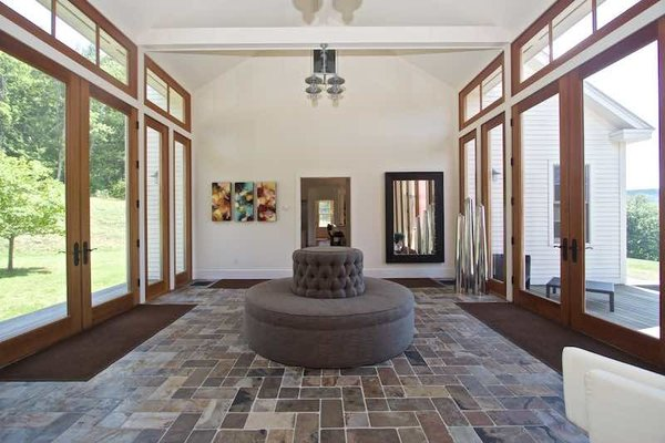 Modern home with hallway. Gallery Flooded with Light with Doors to Mahogany Deck Overlooking Streams Photo 8 of Dennis Wedlick Design Spencertown Home