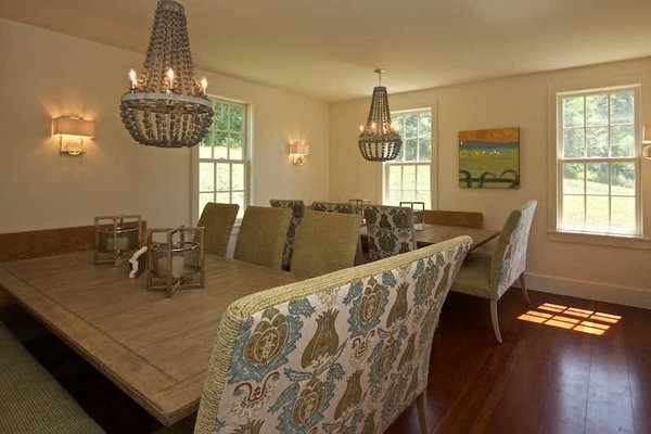 Modern home with dining room, bench, table, chair, ceiling lighting, and medium hardwood floor. Dining Room Perfect for Entertaining Any Holiday Photo 10 of Dennis Wedlick Design Spencertown Home
