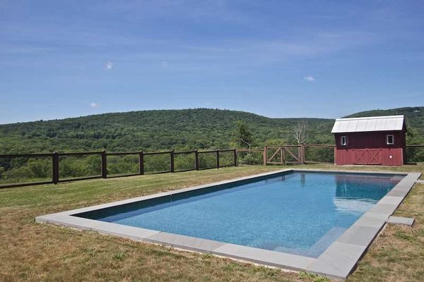 Modern home with outdoor and large pool. Pool Area with Bluestone Patio Outdoor Shower and Changing House All Overlooking Punsit Valley With Not a House In Sight Photo 16 of Dennis Wedlick Design Spencertown Home