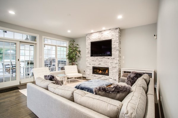 Modern home with living room, medium hardwood floor, and gas burning fireplace. Photo 4 of Arlington Transitional Kitchen and Family Room