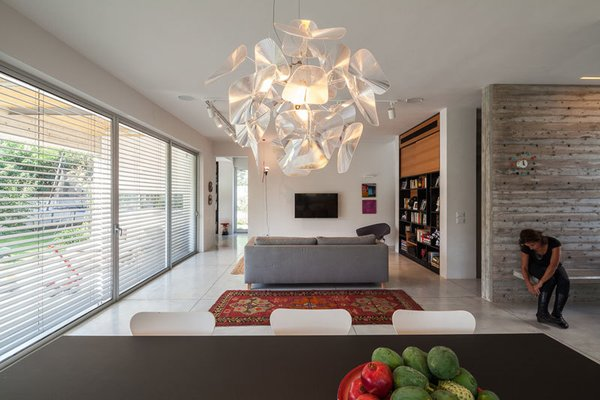 Modern home with table, concrete floor, table lighting, ceiling lighting, pendant lighting, track lighting, living room, bench, sofa, and carpet floor. Photo 5 of Urban Life In The Country