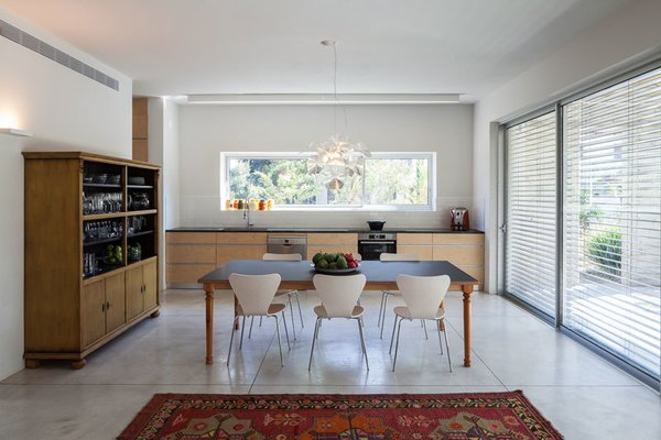 Modern home with dining room, ceiling lighting, storage, table, chair, pendant lighting, and concrete floor. Photo 10 of Urban Life In The Country