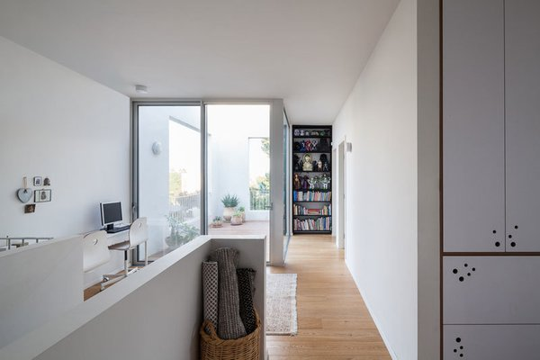 Modern home with kids room, storage, playroom, shelves, medium hardwood floor, pre-teen age, and neutral gender. Photo 11 of Urban Life In The Country