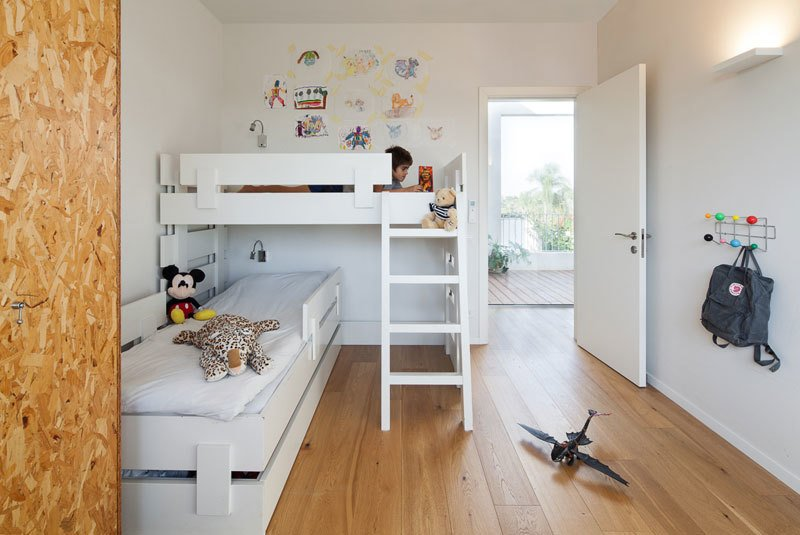 Tagged: Bedroom, Bed, Wardrobe, Wall Lighting, and Medium Hardwood Floor.  Urban Life In The Country by Eshet Alperovich Arch
