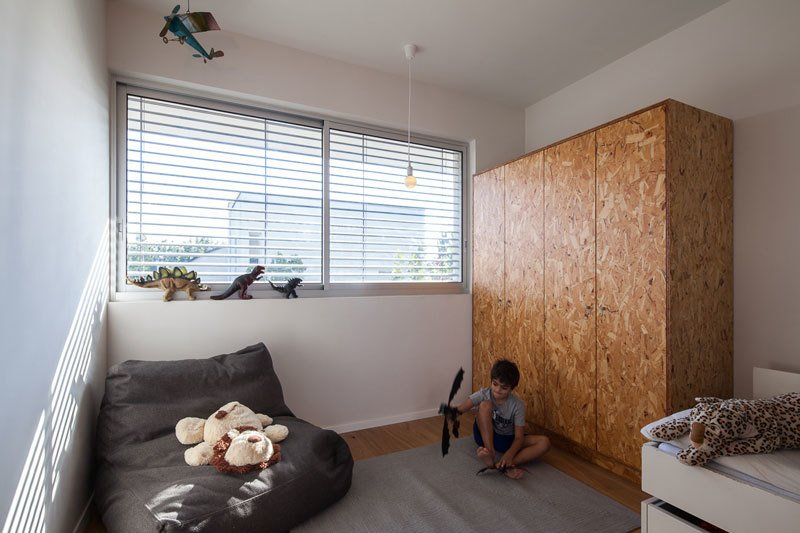 Tagged: Bedroom, Wardrobe, and Medium Hardwood Floor.  Urban Life In The Country by Eshet Alperovich Arch