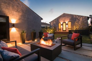 Merging Inside and Out, an L.A. Firm Modernizes a 1940s Abode - Photo 17 of 18 - Backyard Seating & Fire Pit at Night