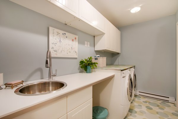 Modern home with laundry room, side-by-side, and white cabinet. Laundry room  Photo 20 of Bayview Road
